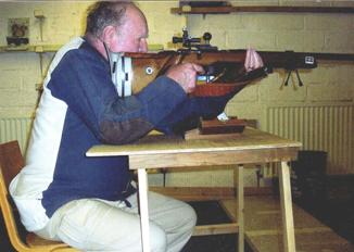 Shooting prone rifle using a table